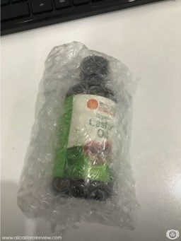 A bottle of Inesscents castor oil covered in bubble wrap