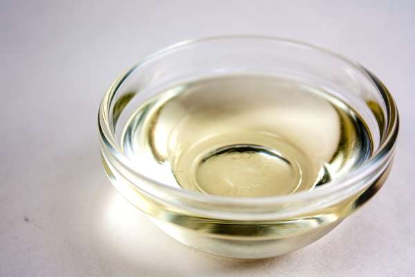 Clear castor oil with pale yellow color